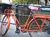 Orange Bike Amsterdam (cafechattycat) Tags: autumn trees urban orange green water amsterdam bike canal basket spokes wheels checkers locked bikebasket orangebike amsterdamcanals amsterdambike amsterdamafternoon