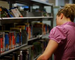 looking for something.. (picture prefect) Tags: girl random library arlingtonva travelbooks shirlington 50mmf14d