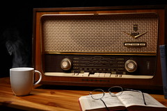 Radio Daze (Ian Hayhurst) Tags: old coffee radio vintage relax grid reading glasses book media break tea drink memories mp3 steam story nostalgia coco wireless stories fm audio softbox vapour grundig narrative longwave reminisce shortwave programme biggles cuppa cto mediumwave canonef24105mmf4lisusm explore1 strobist platinumphoto ezybox 2067we