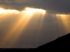 Peeking Through (colonial1637 (off & on)) Tags: sun cloudy rays shining blueribbonwinner platinumphoto
