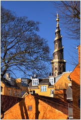 "Christianshavn ""postcard"" with spiral church tower - Copenhagen (HDR) (Jaafar Mestari) Tags: trees houses sky orange tower church copenhagen spiral district postcard spire corkscrew 2009 vor hdr kbenhavn kirke copenhague christianshavn saviour frelsers canonef28mmf18usm canoneos50d"