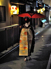 Maiko with red umbrella (RomImage) Tags: street red woman girl yellow japan night umbrella japanese nikon kyoto bokeh tabi maiko geiko geisha nippon obi nikkor soe nihon pontocho geta oiran medievalage colorphotoaward d700