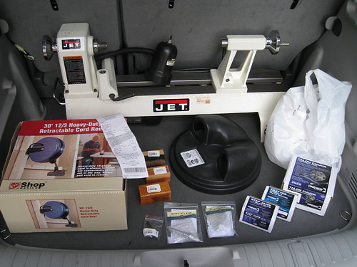 JET lathe, retractable cord reel, bottle stopper blanks and hardware, and dust separator lid in back of rented PT Cruiser
