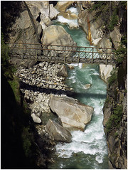 bridge too far - III, beyond harshil (nevil zaveri) Tags: uk travel bridge trees india tree ariel nature water pine forest river landscape flow photography blog rocks photographer view photos stones religion stock places images holy boulders photographs photograph jungle rivers uttaranchal gorge himalaya zaveri ganga gettyimages ua stockimages ganges travelogue conifer gangotri nevil tributary bhagirathi harshil jahanvi chardham uttarkhand theverybestofme nevilzaveri