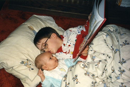 Will (5) and Christina (2 months) during a relaxed day of our early homeschooling, 1990.