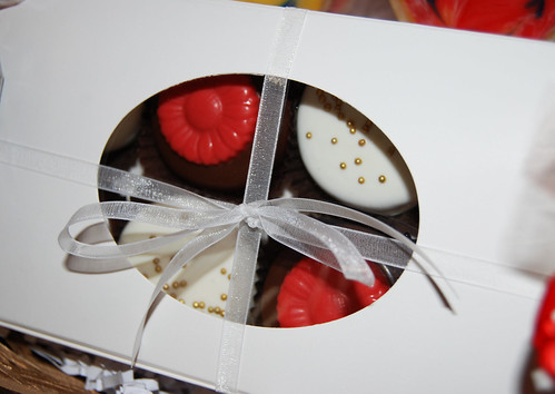 red and gold chocolate dipped oreos boxed