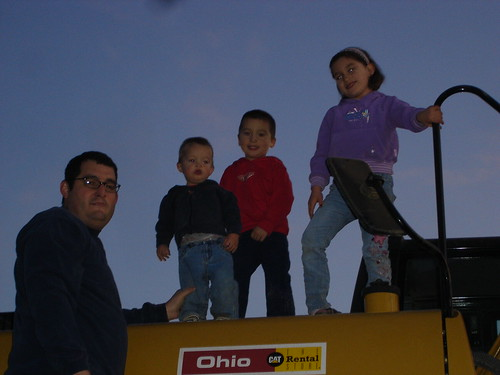 Everyone posing on the excavator