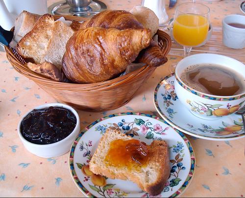 coffee ceramic bowl grilled bread jam chocolate croissant