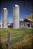 Old Silos (ETCphoto) Tags: new old texture grass barn fence decay michigan bluesky silos traversecity 8906 skeletalmess