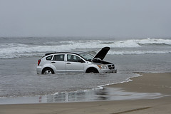 Car stuck in the surf