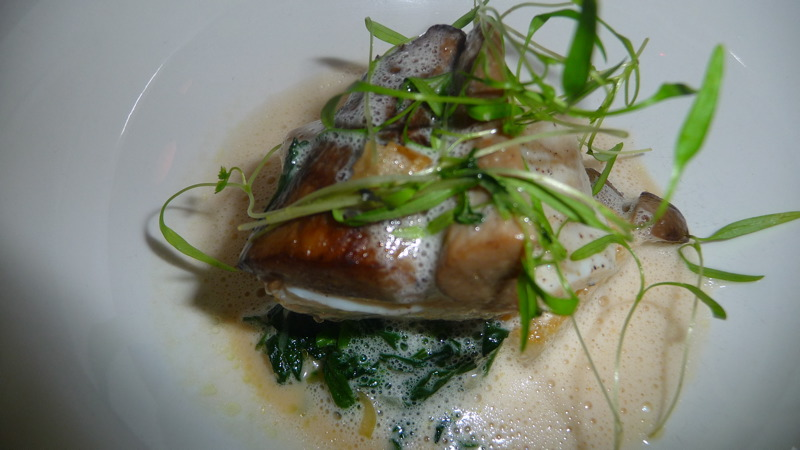 Wild striped bass with watercress and coconut sea urchin broth at JLOB