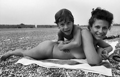 la plage..... (manuel cristaldi) Tags: sea blackandwhite bw italy woman sun film 35mm blackwhite noiretblanc stones trix dream august beautifulwomen sicily marco relatives summertime plage minox spiaggia minox35gt 1025favorites schwarzweis greatpixgallery10faves fondachello views5000 flickraward manuelcristaldi feltlife coolestphotographers myverypersonalbw blackwhitepassion blackandwhitelove manuelcristaldi