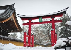 The Gateway in Winter. (Hirosaki Japan).  Glenn Waters.  1,100 visits to this photo.   Thank you. (Glenn Waters in Japan.) Tags: red white snow japan architecture temple 50mm nikon gate shrine f14 14 sigma peaceful aomori  hirosaki tori   jinja tera    5photosaday nikond700  glennwaters sigma50mmf14exdghsm
