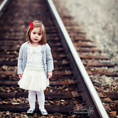 ella on the tracks (jaki good miller) Tags: portrait girl interestingness traintracks adorable explore littlegirl exploreinterestingness jakigood railroadtracks redbow top500 explorepage explored beautifullittlegirl mywinners threeyearoldgirl