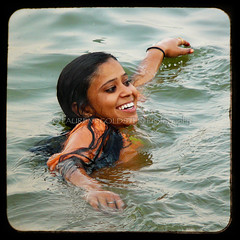 A Seeming Mermaid Steers (designldg) Tags: people woman india water beauty smile youth colours symbol expression atmosphere happiness muse panasonic ethereal varanasi mermaid shanti waterdrops ganga ganges ghats benaras uttarpradesh  corporeal indiasong dmcfz18
