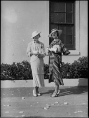 Two women racegoers at Warwick Farm racecourse (Powerhouse Museum Collection) Tags: window hat fashion clothing women litter gloves rubbish heels bushes powerhousemuseum xmlns:dc=httppurlorgdcelements11 dc:identifier=httpwwwpowerhousemuseumcomcollectiondatabaseirn388546