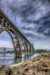 Crossing Yaquina Bay (ThinkHDR) Tags: bridge blue sky water rock clouds oregon bay coast sand crossing cross wind windy newport tall gleaming vibrance beachbeautiful