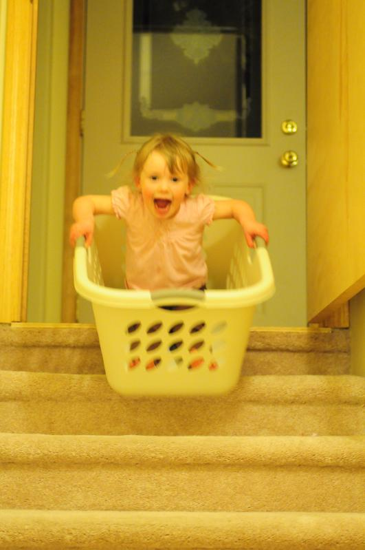 Riding down the stairs in a basket
