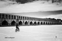cyclist in Zayandehrood (Alieh) Tags: bridge blackandwhite bw snow water architecture river persian iran persia historical iranian  esfahan isfahan     33pol zayandehrood  aliehs alieh 33          saadatpour 33bridges  snowypeopleproject