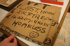 homeless sign: lost home in fire