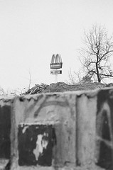 Parasite (bartekodias) Tags: city urban blackandwhite bw film analog corporate blackwhite decay destruction urbandecay debris poland polska delta demolition negative 400 damage ilford ilforddelta400 parasite conquest lodz łódź nikonn75 n75 f75 ilforddelta nikonf75 autaut dp400 corporateconquest