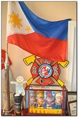 Stanley - Flag Ceremony (hubsio) Tags: philippineflag flag redblue 3starsandasun star sun federationfire fedfire maltesecross firefighter firehouse stanley toy hubsio nikon d90 hubertsio huberts sigma 1850 nozzle plaque