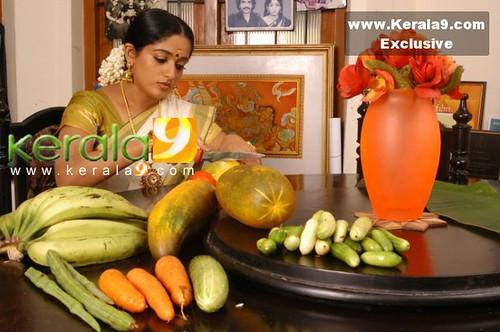 Kavya with moringa, cucumbers, bananas, carrots, etc.