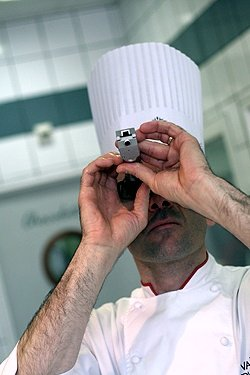 chef givre checking his refractometer