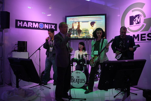 Some Harmonix booth attendees trying out The Beatles: Rock Band (click).
