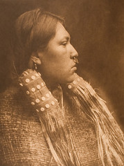 A Hesquiat Maiden (Museum of Photographic Arts Collections) Tags: portrait woman photography buttons indian profile jewelry nosering 1910s 1915 weaving maiden nativeamericans curtis americanindian museumofphotographicarts hesquiat edwardsheriffcurtis