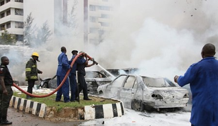 Two people were reported killed in the Federal Republic of Nigeria political capital of Abuja when a bomb was placed at the national police headquarters. Authorities suspected the northern-based Boko Haram. by Pan-African News Wire File Photos