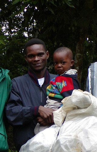 Corneille and his son in the Ituri Forest. In 2005 Corneille Ewango won the prestigious Goldman conservation award for his heroic actions to save the Okapi Reserve and its staff during Congo's recent civil war.