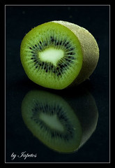kiwi (iapetos-1(crazy father)) Tags: plants macro reflection nature fruits closeup fruit reflections natur kiwi lightbox kiwifruit anawesomeshot canoneos40d overtheexcellence iapetos1