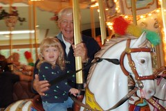 Catie & Pop-Pop on the merry-go-round