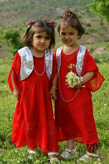 Enjoy a Spring Day in Kurdistan (kezwan) Tags: red flower girl spring kurdistan kurd kezwan 1on1people