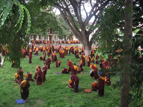 Debate on the cool, grassy lawn of Namdroling Monastery