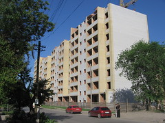 Public housing UC (Phnom) Tags: russia south don city urban taganrog outskirts architecture building brick white yellow crane underconstruction toppedout library glass windows publicblock publichousing apartment residential comieblock office