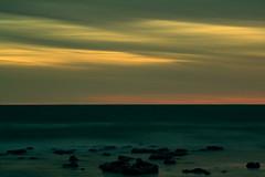 The Stillness of Stone (.Nigel.) Tags: ocean longexposure light sea sky colour beach water night clouds twilight waves melbourne williamstown