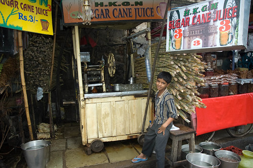 Kid selling sugar cane juice