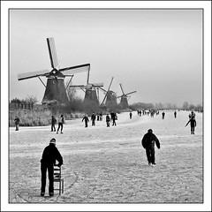 With a little help (Focusje (tammostrijker.photodeck.com)) Tags: winter holland mill ice netherlands canal frozen chair skating nederland row mills 2008 stoel 2009 kinderdijk schaatsen zuidholland winter20082009
