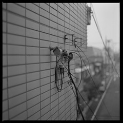 Repeat Yourself And Fail Again (gullevek) Tags: sky blackandwhite building 6x6 japan wall tokyo bokeh wires electricity   ilford housebuilding  iso125 ilfordfp4125 epsongtx900 bronicaectl autaut zenzanonmc80mmf24