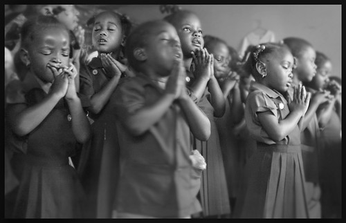 Children praying at Chapel Hill School