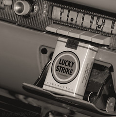 Smokes and AM Radio (Jim Frazier) Tags: show old blackandwhite bw classic cars monochrome car sepia radio illinois am mechanical antique july dupage manipulation il equipment machinery vehicles dash desaturated f3 dashboard luckystrike machines ashtray 2008 tobacco classiccars automobiles carshow q3 apparatus devices warrenville cruisenight cigaretttes oldified dupagecounty omegarestaurant 20080722warrenvillecarshow ld2009 ldfebruary 080722e
