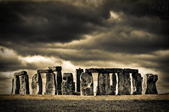 Dark Skies Over Stonehenge Redux (Sean Molin Photography) Tags: uk greatbritain trip travel vacation england bw holiday london rock stone sepia religious march blackwhite europe european unitedkingdom sightseeing landmark stonehenge british druid drama epic 2009 salisburyplain archaic blueribbonwinner platinumphoto nikond700 lensers vacationeuropeenglandunited kingdom2009marchv kingdom2009marchvacationbritain seanmolin wwwseanmolincom