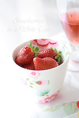 Strawberries_in_white_cap (nadiya9) Tags: light food sun white cup glass rose cake bread strawberry wine tea plate spoon fresh oat