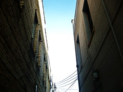 Bright Sky, Dark Alley (dustinsimmonds) Tags: city minnesota dark town alley little falls mn
