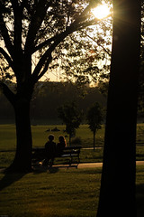Regents Park Sunset (Brian Krijgsman) Tags: park trees sunset people sun green london yellow bench evening nikon couple afternoon candid foliage flare gps nikkor d3 regentspark regents unit gp1 28200mmf3556d nikond3 afzoomnikkor28200mmf3556dif