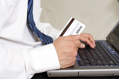 Online buying (Heberger Site) Tags: people shop businessman computer shopping notebook office keyboard order laptop unitedstatesofamerica internet business card credit pay online buy workplace ecommerce financial charge purchase checkout loan finance spending buying spend transaction debit