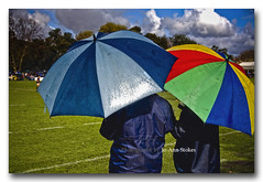 Come rain & shine! (Jo-Ann Stokes) Tags: school field rain clouds colours rugby vibrant umbrellas supporters bystanders onlookers flickrsbest