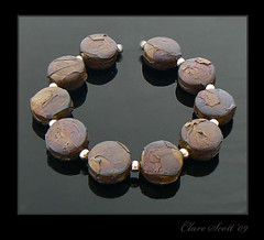Spellbinding (on silver brown) - Lampwork glass bead set (Photography by Clare Scott) Tags: glass silver scott clare plum bead shards sra beadsbyclarescott